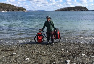 Wes standing with bike at the shore in Bar Harbor