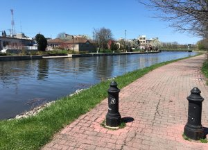 The towpath, in this section covered with cobble stones, and the Erie Canal to the right.