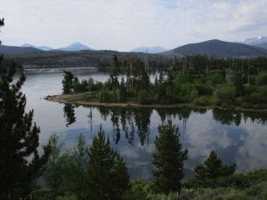 Dillion Reservoir--There mountains in the background, and island with conifers and shrubs