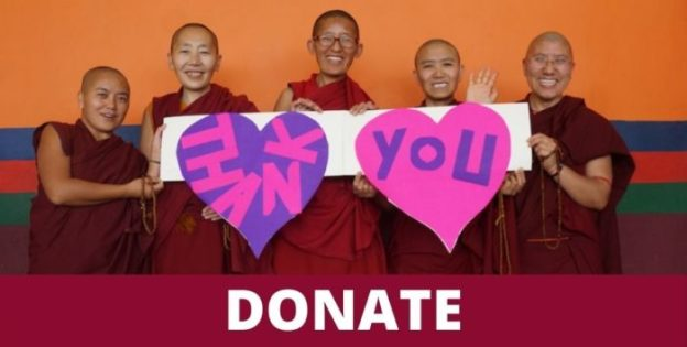 Group of Tibetan Buddhist nuns holding a thank you sign, 2021 message
