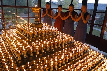Tibetan Buddhist nuns and butter lamps by Brian Harris