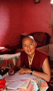 Tibetan Buddhist nun studying Olivier Adam