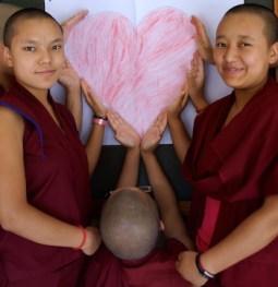Tibetan nuns holding heart
