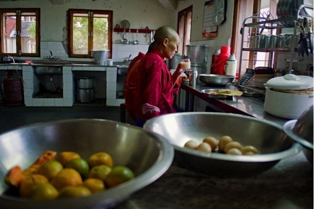 Tibetan Buddhist nun in kitchen at Dolma Ling Nunnery