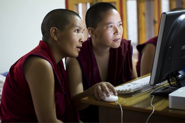 photo by Harald Weichhart showing 2 Tibetan Buddhist nuns at a computer