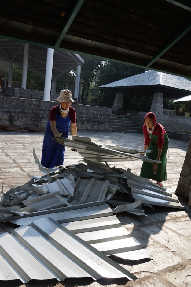 nuns working on metal roof debate courtyard Tibetan Nuns Project
