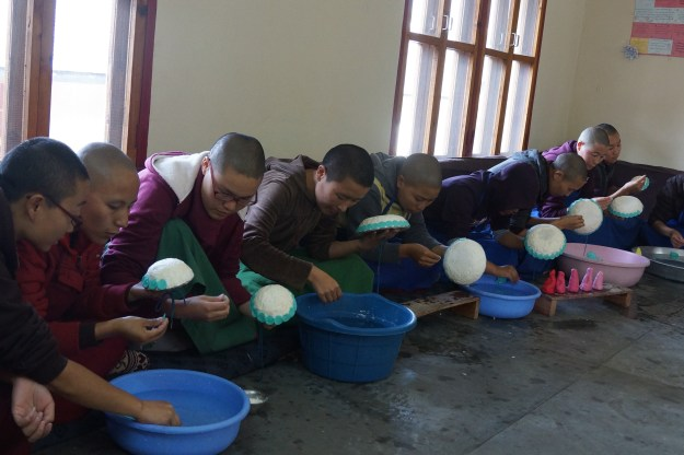 The nuns of Dolma Ling Nunnery making traditional Tibetan butter sculptures