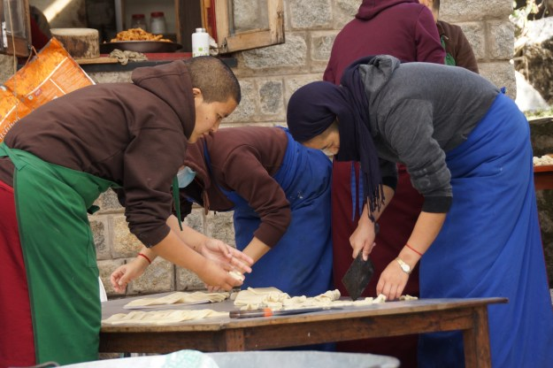 Picture of Tibetan Buddhist nuns making traditional khapse for Losar, Tibetan New Year