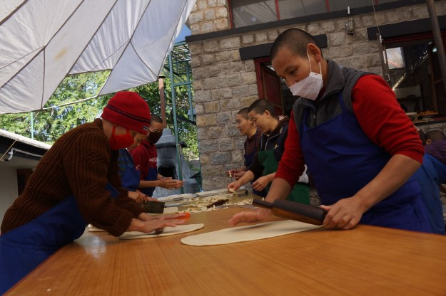 Nuns of Dolma Ling Nunnery Tibetan Buddhist nuns making khapse for Losar on March 2nd