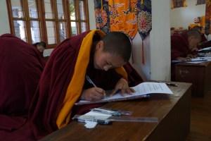 Tibetan Buddhist nun sitting exams