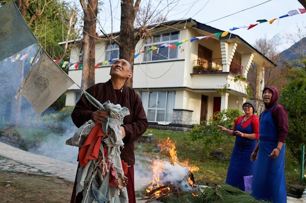 nuns remove and burn old prayer flags