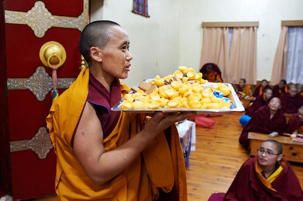 nun bringing in blessed food
