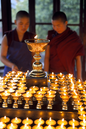 two Tibetan nuns and butter lamps