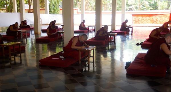 Tibetan Buddhist nuns writing their Geshema exams.