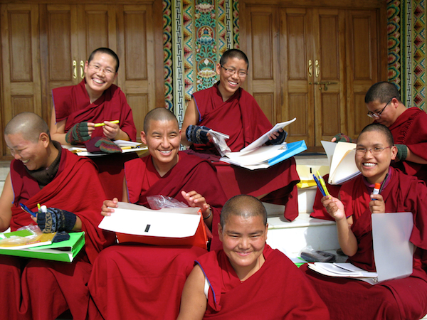 Sakya nuns holding gifts from sponsors