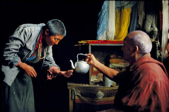 Brian Harris, Tibet, nun receiving blessed water,