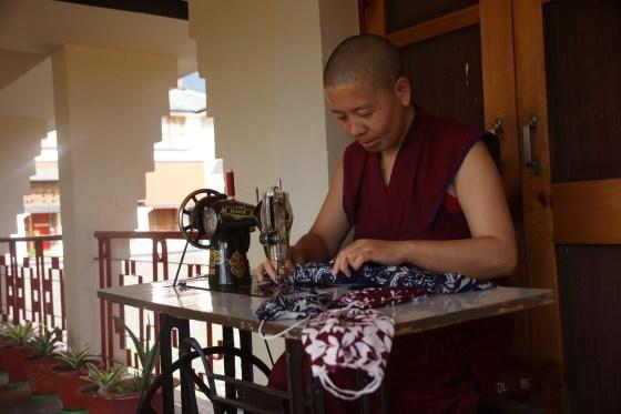 Tibetan Buddhist nun makes cloth masks