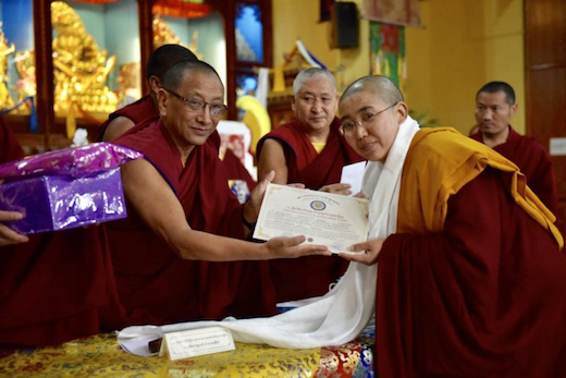 Geshema, Tantric studies, Kalon Ven Karma Gelek Yuthok conferring certificate to a Geshema Tenzin Phende CTA