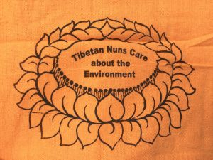 Orange Shopping Bag is made of cotton, reusable and eco-friendly with Tibetan Nuns Project screenprint on both sides, handmade by Tibetan nuns.