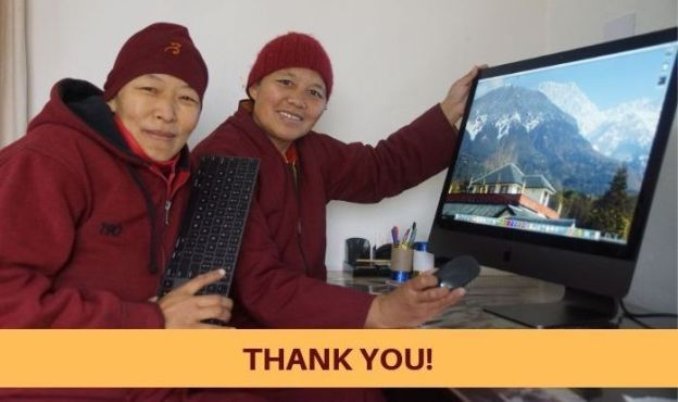 Tibetan Buddhist nuns with media equipment