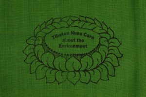 Shopping Bag Green is made of cotton, reusable and eco-friendly with Tibetan Nuns Project screenprint on both sides, handmade by Tibetan nuns.