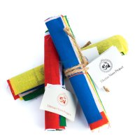 Tibetan multi-colored prayer flags are inscribed with auspicious symbols, invocations, prayers, and mantras, Prayer flags bring happiness, long life and prosperity
