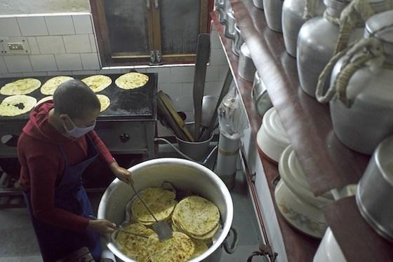 Tibetan Buddhist nuns cooking breakfast