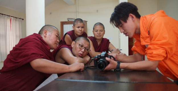 Tibetan Buddhist nuns learn how to use cameras