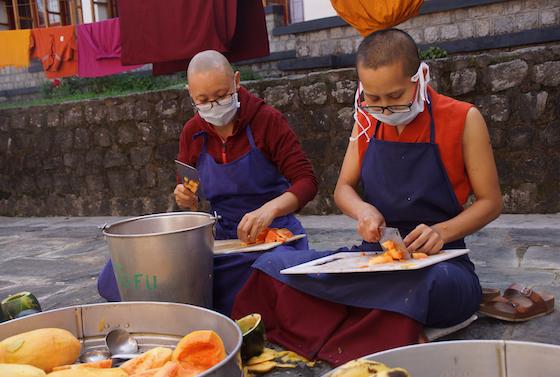 chopping papayas, Dolma Ling kitchen, Tibetan Buddhist nuns cooking