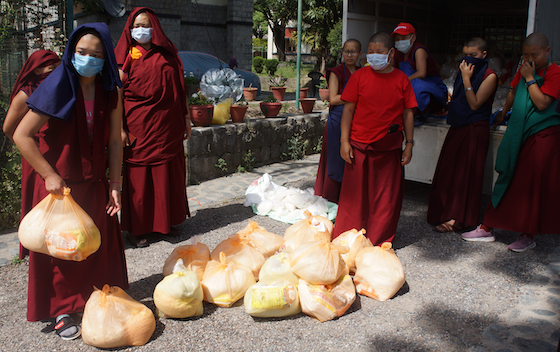 Tibetan Buddhist nuns distribute food during coronavirus pandemic, coronavirus lockdown, Dolma Ling nuns, food relief