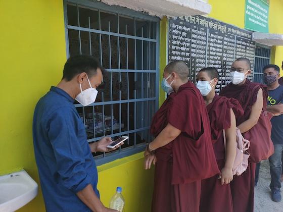 Tibetan Buddhist nuns get vaccinated for coronavirus