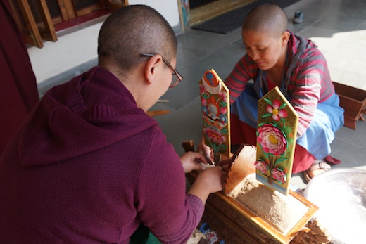 Tibetan nuns making butter sculptures for Losar