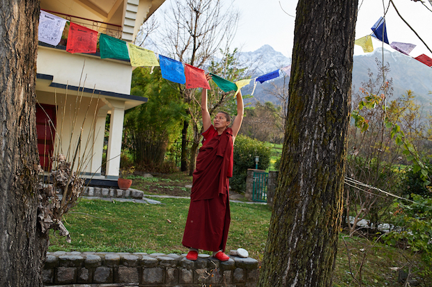 hanging new prayer flags, Tibetan prayer flags, Tibetan Nuns Project