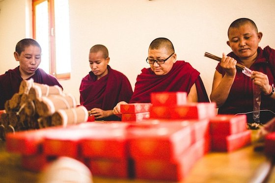 Nuns at Khachoe Ghakyil Ling Nunnery in Nepal making incense. Photo courtesy of DharmaShop