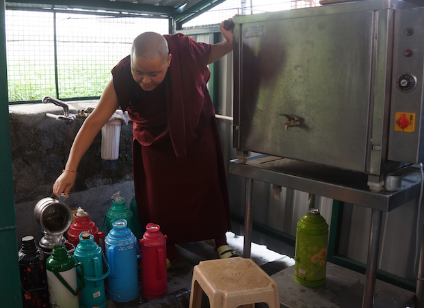 Tibetan nun filling thermoses