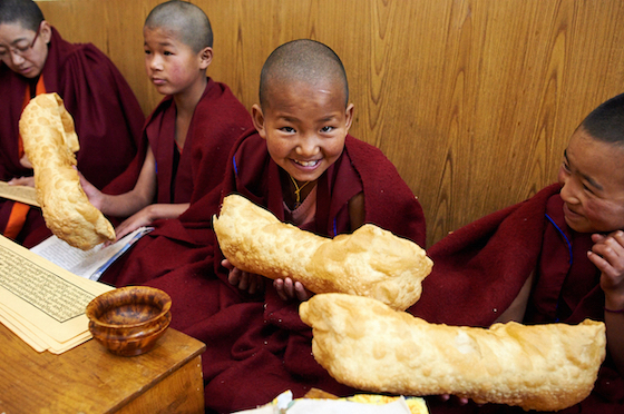 Young Tibetan Buddhist nuns holding Losar khapse