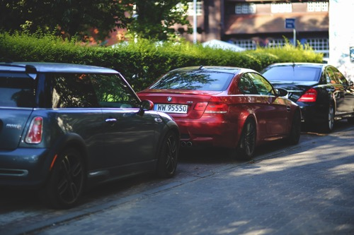 Cars parked along way 2