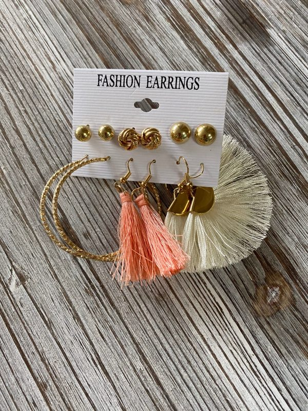 assorted pairs of earrings