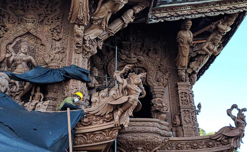 Worker busy carving Pattaya's Wood Temple