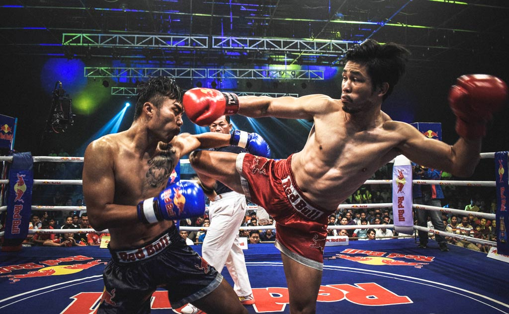 A Muay Thai (Thai Boxing) fight in a Bangkok stadium.