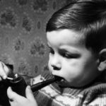 B4M7RM Smoking at an early age for 2 year old Hugh Condron Would you let your two year old son smoke and drink Chubby Hugh Condron of M