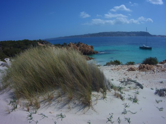 View of our Sailboat from an island in La Maddalena archipelago.