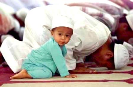 muslims in prayer w cute kid