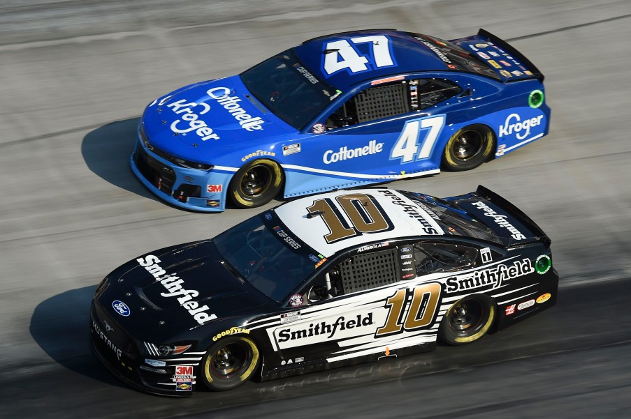 BRISTOL, TENNESSEE - JULY 15: Aric Almirola, driver of the #10 Smithfield Ford, races Ricky Stenhouse Jr., driver of the #47 Kroger/Cottonelle Chevrolet, during the NASCAR Cup Series All-Star Open at Bristol Motor Speedway on July 15, 2020 in Bristol, Tennessee. (Photo by Jared C. Tilton/Getty Images)