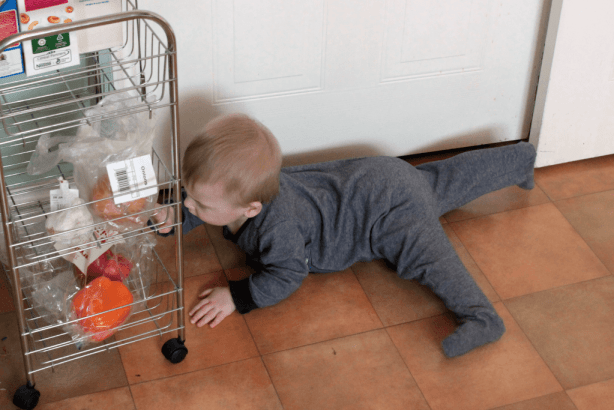 nine months old exploring the vegetables