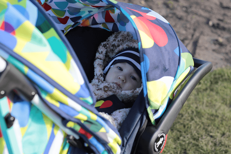 Gabe comfy in the To & Fro travel system
