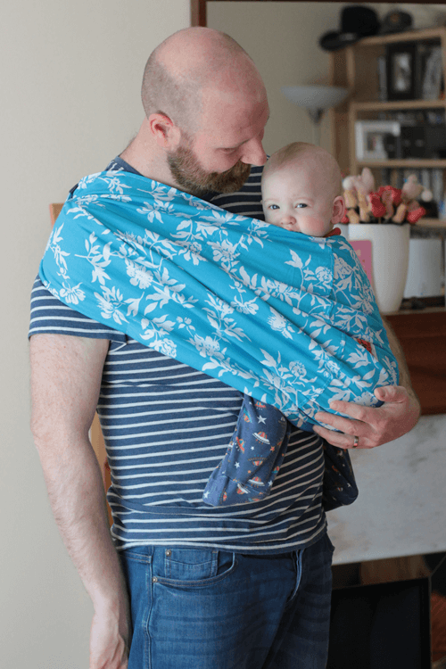 Daddy using the Rockin' Baby pouch