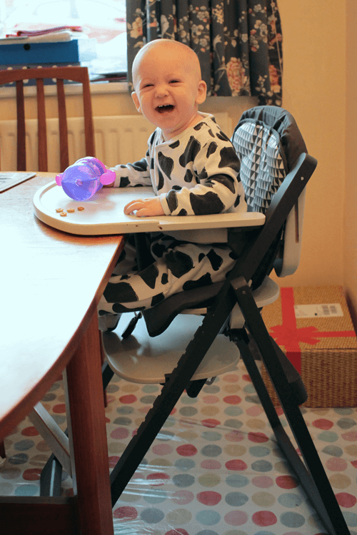 Sitting up at the table in the Babymoov Light Wood high chair