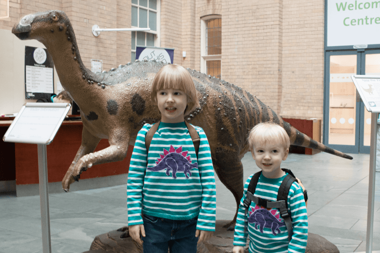 Toby and Gabe with a dinosaur at the World Museum Liverpool