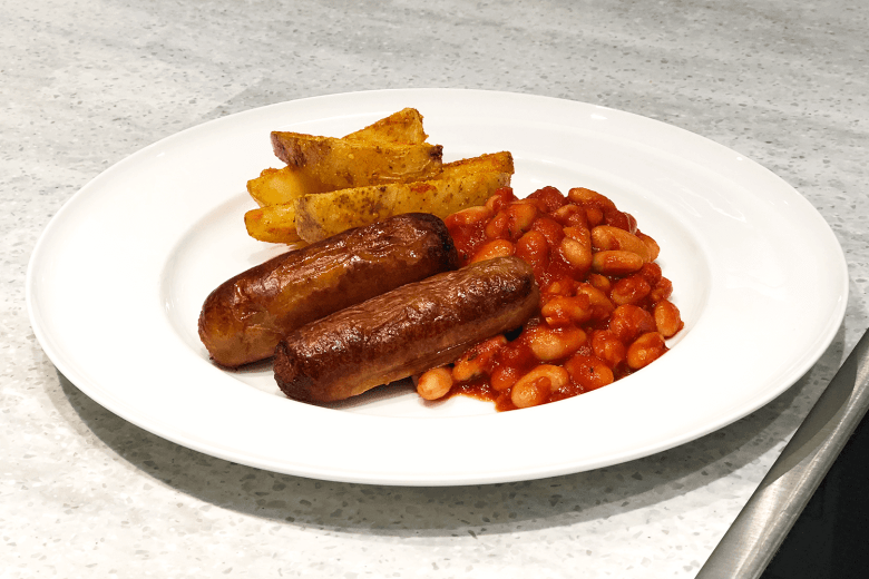 Richmond chicken sausages with cheesy wedges and homemade baked beans